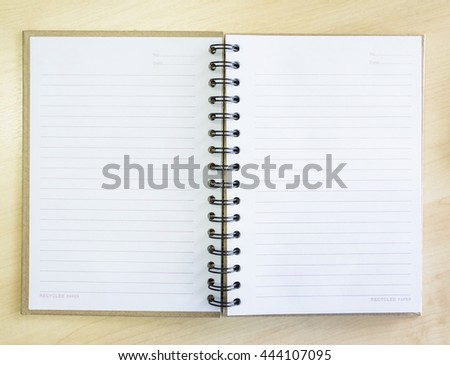 Top View of Paper Notebook, Notepad Paper on Business Desk for Successful Cooperation Concept Backgrounds.