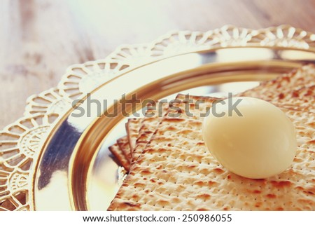 top view of passover background. egg and matzoh (jewish passover bread) over wooden background.  - stock photo
