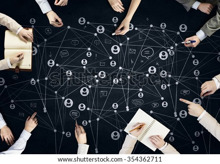 Top view of people hands drawing networking strategy - stock photo