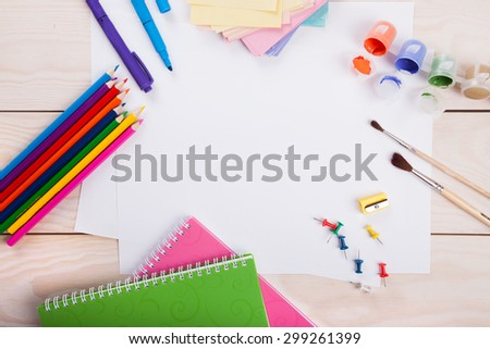 Top view of piece of paper and school supplies on the  wood background - stock photo