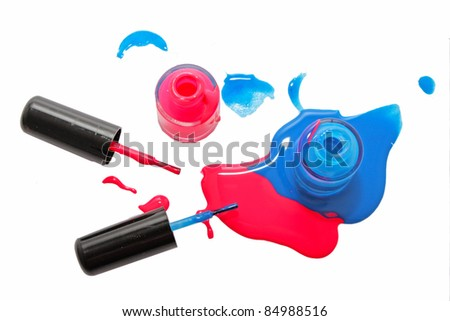 Top view of pink and blue shimmering nail polish on white background - stock photo