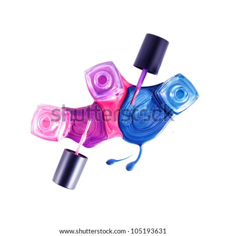 Top view of pink, blue, marine shimmering nail polish on white background - stock photo