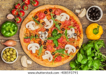 Top view of pizza with mushrooms over wooden table