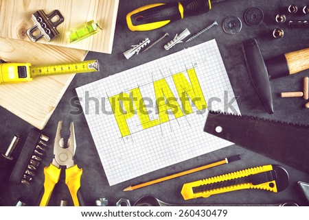 Top View of Project Plan For Home Redecoration Work with Paper, Pencil and Assorted Woodwork and Carpentry Tools on Workshop Table - stock photo