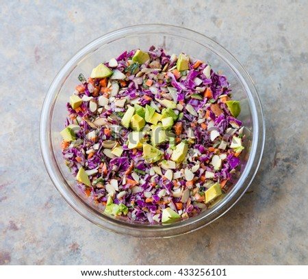 Top view of rainbow slaw with Avocado in a bowl - stock photo