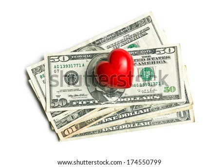 top view of red heart of stone on american dollars on white background - stock photo
