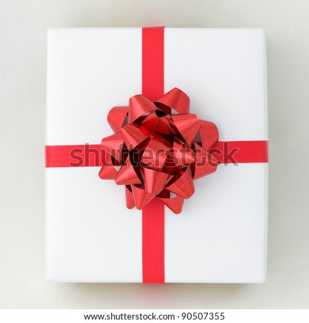 Top view of Red star and Cross line ribbon on White paper box, Gift for Special Day