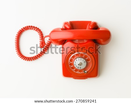 top view of red vintage phone on white background - stock photo