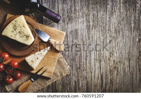 Top View Of Red Wine And Cheese On Rustic Wooden Background With Copyspace French Cuisine