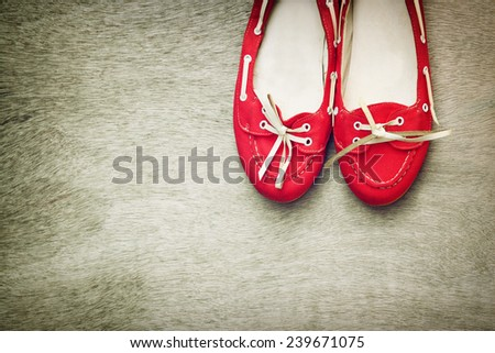 top view of red worn woman shoes over wooden textured background. instagram style filter - stock photo