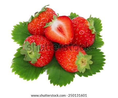 Top view of ripe strawberries pile with green leaves isolated on white background - stock photo