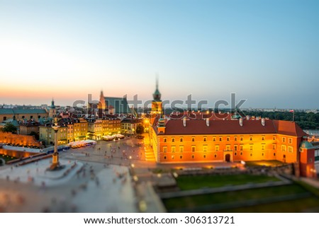 Top view of Royal castle and old town crowded with people in Warsaw on the evening - stock photo