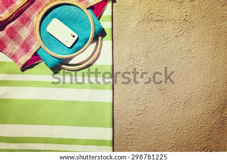 Top view of sandy beach with summer accessories and copy space - stock photo