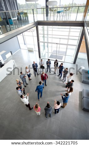Top view of satisfied manager congratulate to worker and shake hands - stock photo