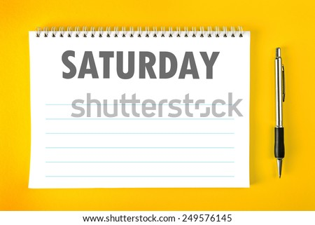 Top View of Saturday Paper Calendar Blank Page with Spiral Binding as Time Management and Schedule Concept. - stock photo