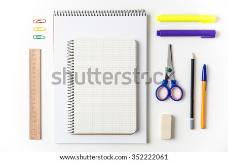 Top view of school and office supplies set isolated over white background - stock photo