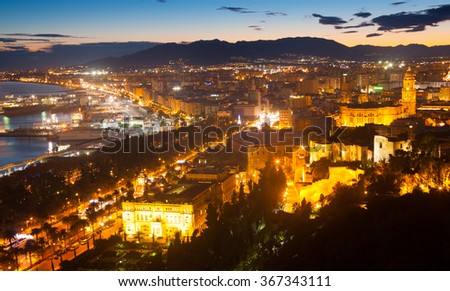 Top  view of seaside part of Malaga from castle in  evening time. Spain - stock photo