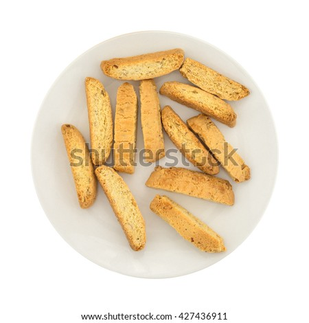 Top view of several almond nut biscotti on a plate isolated on a white background. - stock photo