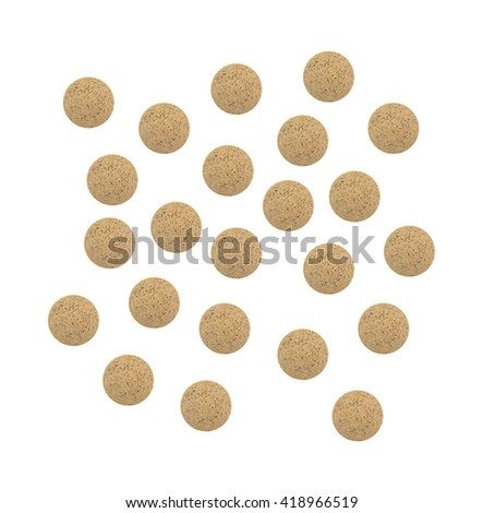 Top view of several brewer's yeast nutritional supplement tablets isolated on a white background. - stock photo