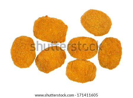 Top view of several cooked breaded chicken nuggets on a white background. - stock photo