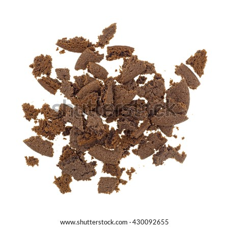 Top view of several Dutch cocoa cookies crumbled into pieces isolated on a white background. - stock photo