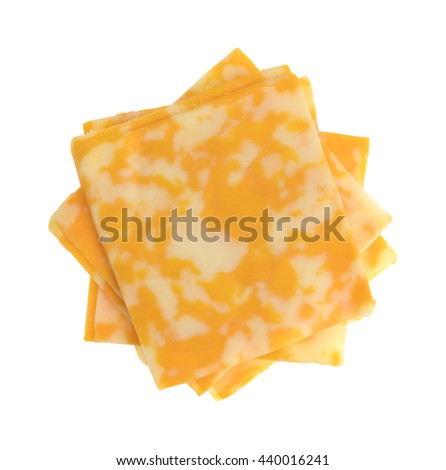 Top view of several slices of Colby-Jack cheese in a stack isolated on a white background.
