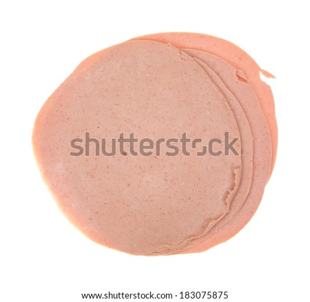 Top view of several slices of German baloney on a white background. - stock photo