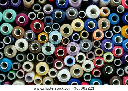 Top view of sewing threads pushed all together like tiles. - stock photo