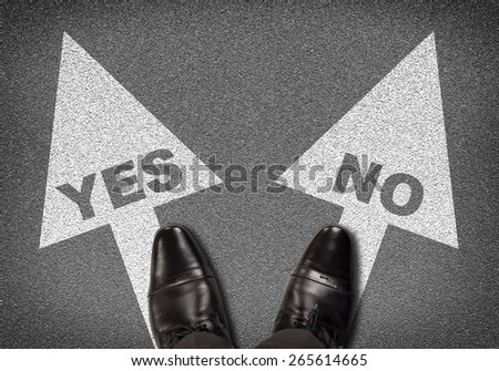 Top view of shoes standing on asphalt road with two arrows. Labels YES and NO. Business concept - stock photo