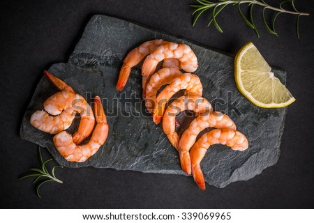 Top view of shrimps on black slate - stock photo