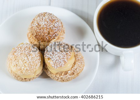 Top view of shu pastries with coffee - stock photo
