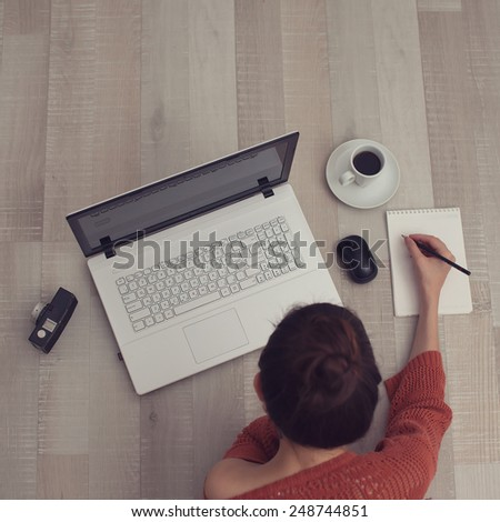 top view of sketching woman - stock photo