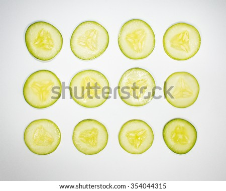 Top view of slices cucumber isolated on white background. - stock photo