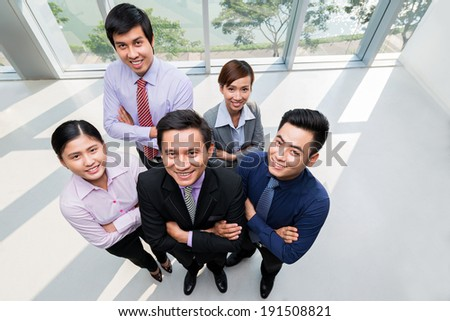 Top view of smiling business team - stock photo