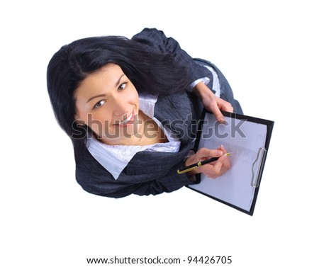 Top view of smiling business woman writing in clipboard - stock photo