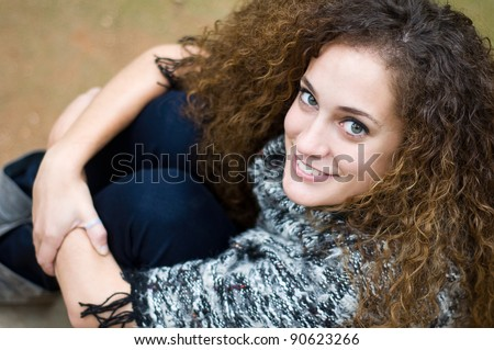 Top view of smiling girl with long curling hair