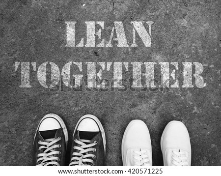 Top View of Sneaker Shoes on the floor with the text: Lean together