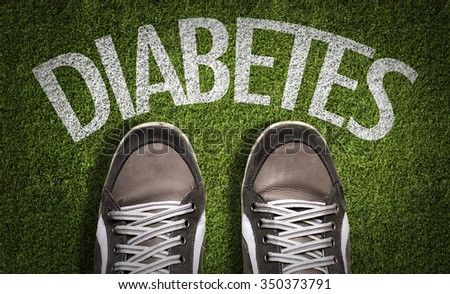 Top View of Sneakers on the grass with the text: Diabetes - stock photo