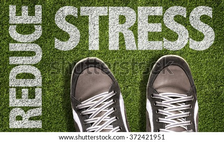 Top View of Sneakers on the grass with the text: Reduce Stress - stock photo