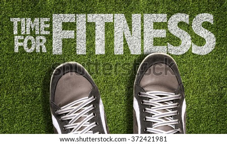 Top View of Sneakers on the grass with the text: Time for Fitness - stock photo