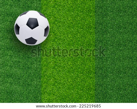 Top view of soccer or football on grass field  - stock photo