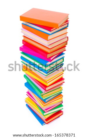 Top view of stacked colorful books on white background