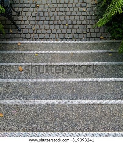 Top view of staircase from house to the garden. - stock photo