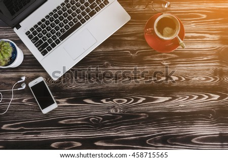 Top view of stuff office desktop and copy space with sunlight - stock photo