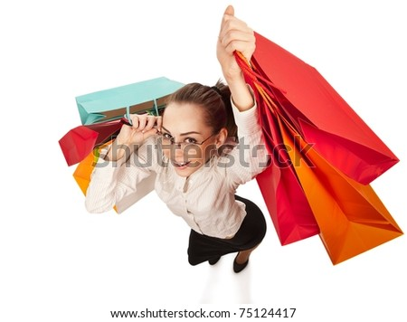 Top view of stylish woman swinging her arms  with shopping bags over white - stock photo