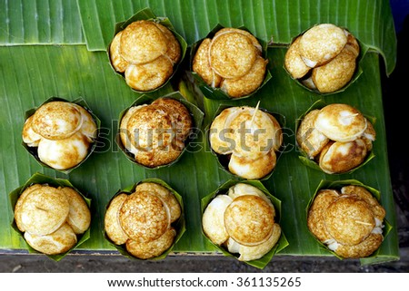 Top view of Sweet and Savory Grilled Coconut-Rice Hotcakes, Coconut Rice Cake, Asian dessert, Thai, Thailand, Luang Prabang, Laos - stock photo