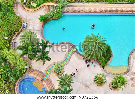 Top view of swimming pool in the park view resort - stock photo
