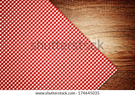 Top View of Table cloth, kitchen napkin on wooden table as background