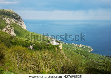 Top view of the city with a bird's-eye view. Seaside Resort. Holiday cottage settlement. Sea Bay Yacht Club. Hotels and B & Bs in the recreational area. Seascape. mountainous landscape - stock photo