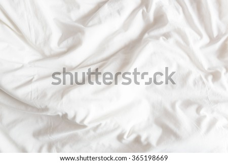 Top view of the crease of an unmade bed sheet in the bedroom after a long night sleep and waking up in the morning. - stock photo